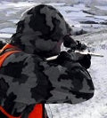 A man in a hunting jacket for cold climates