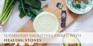 Superfood smoothies paired with healing stones