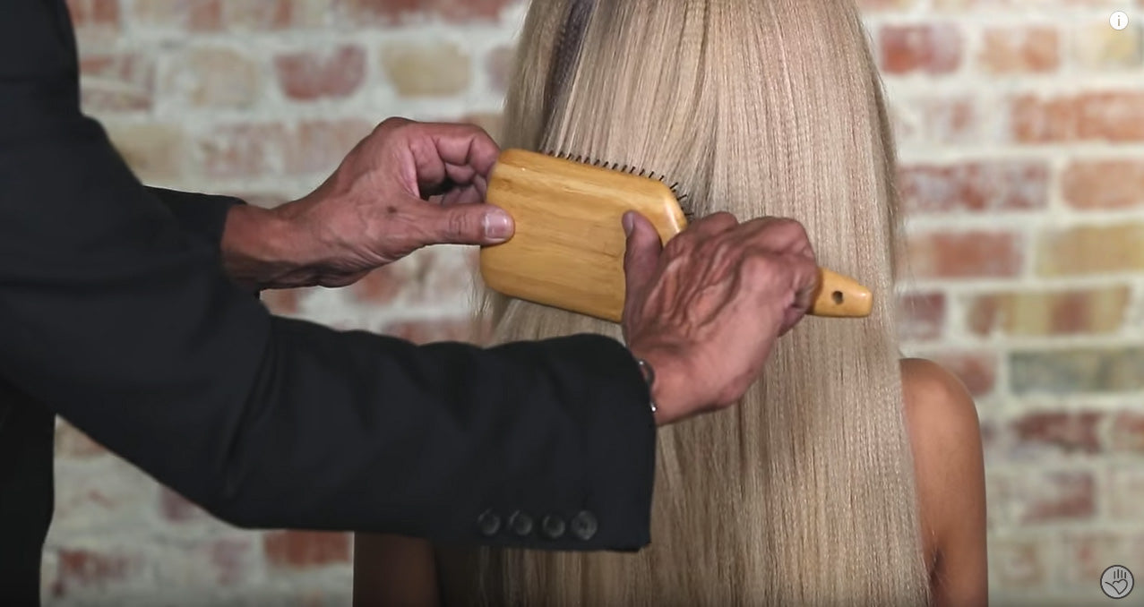 When removing tangles from hair, do not hold the brush horizontally as it will become more difficult to brush through the hair.