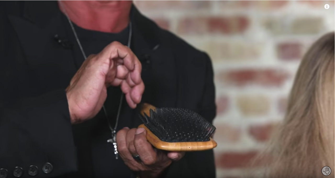 A paddle brush held vertically is perfect when you want to remove tangles from hair