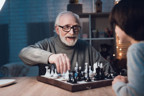 Old Man Playing Child in Chess