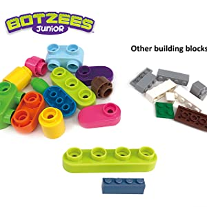 Bright colors and large blocks offer a unique play experience. - Botzees Junior - Jungle Animals