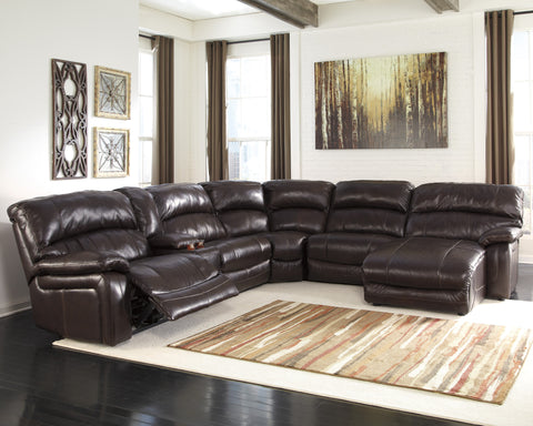 Damacio Reclining Chaise Sectional with Console Storage - Dark Brown