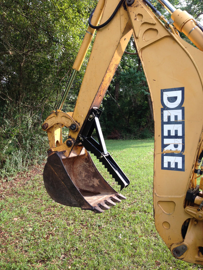 Backhoe attachment thumb
