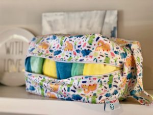 Candies-cloth-nappies-in-a-Candie-Pod-wetbag-with-dinosaurs-on-it
