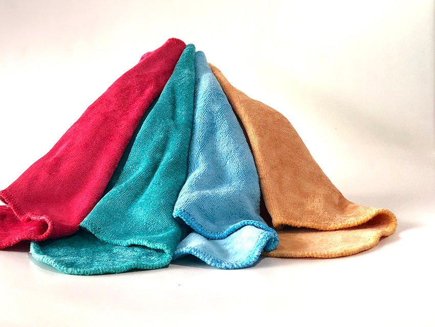Reusable cloth wipes in a rainbow of colour made from luxuriously soft bamboo velour.