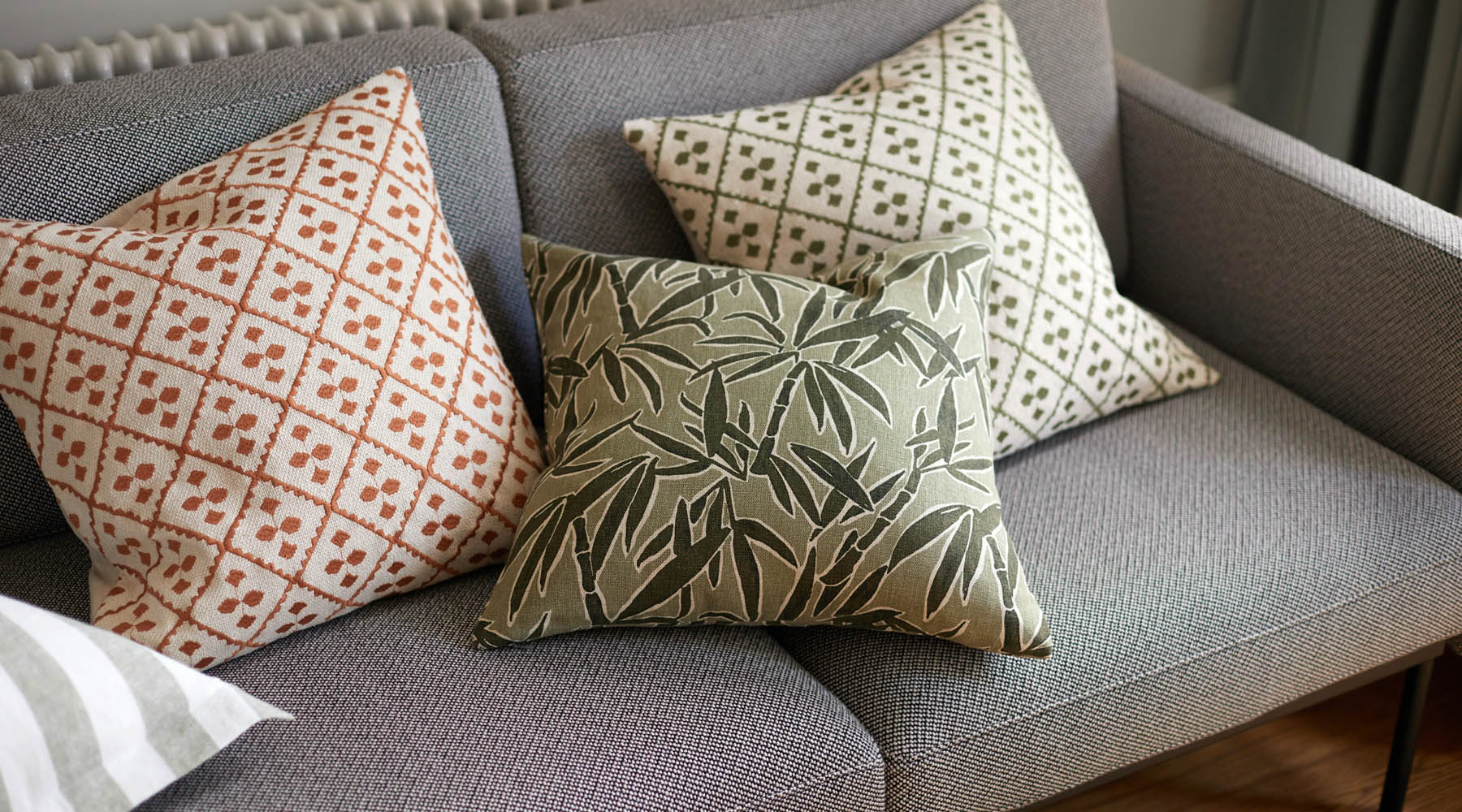 Guadeloupe Olive cushion in lounge