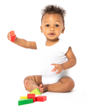 Baby with wooden toys
