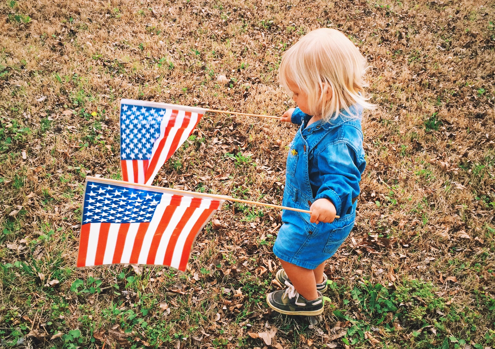Little Girl Holding two American Flags