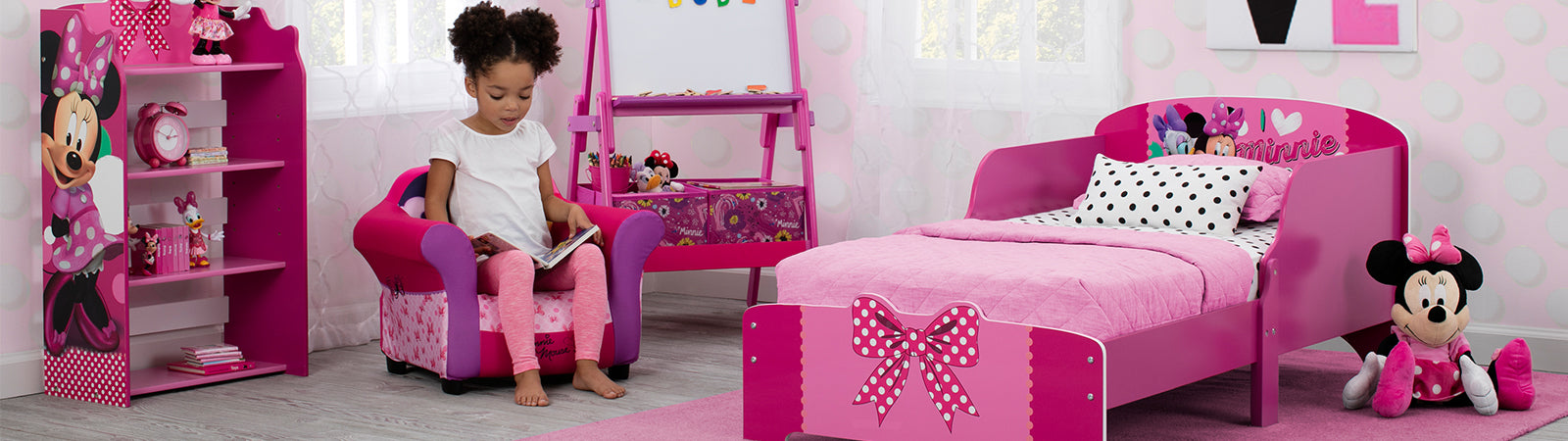 Home · Kid Chairs. Girl Reading Next To Minnie Mouse Wooden Bed