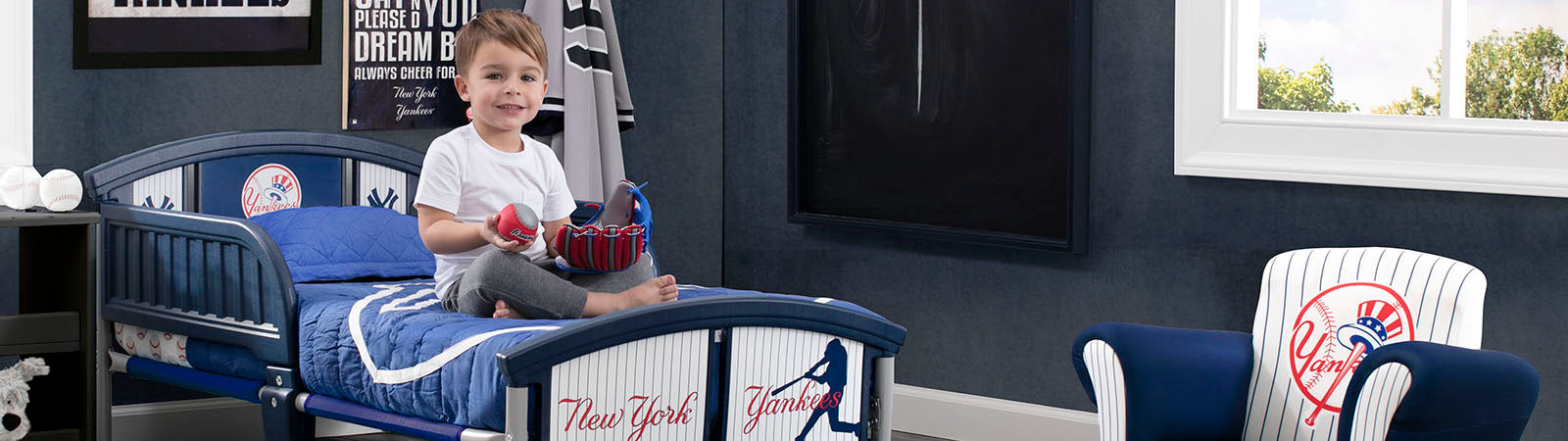 Little Boy spending time in his New York Yankees room