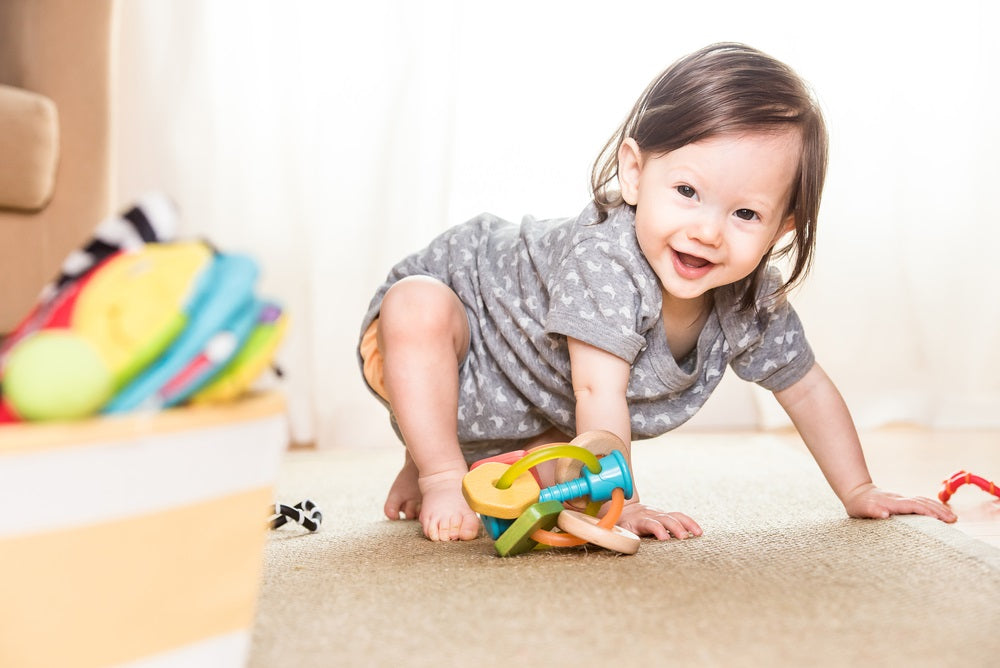 crawling baby learning to use her feet