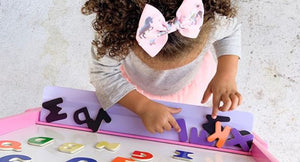 Babby plaing with letters