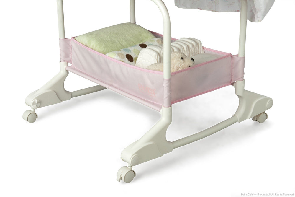 Delta Children Dream Princess Rocking Bassinet, Storage Detail