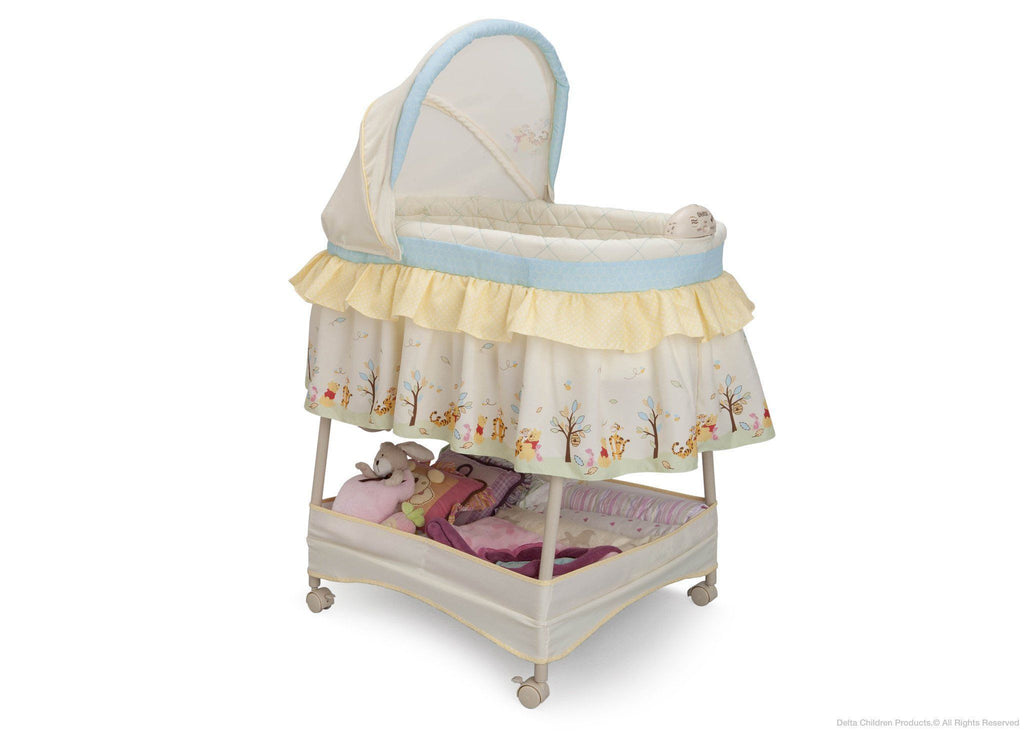 Delta Children Disney Nutopia Gliding Bassinet, Side View a1a
