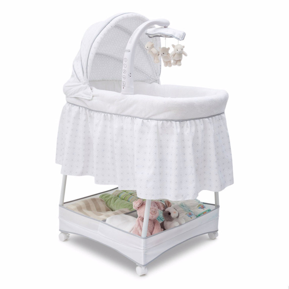 Delta Children Ivory (124) Slumber Time Elite Gliding Bassinet, Right Side View a1a