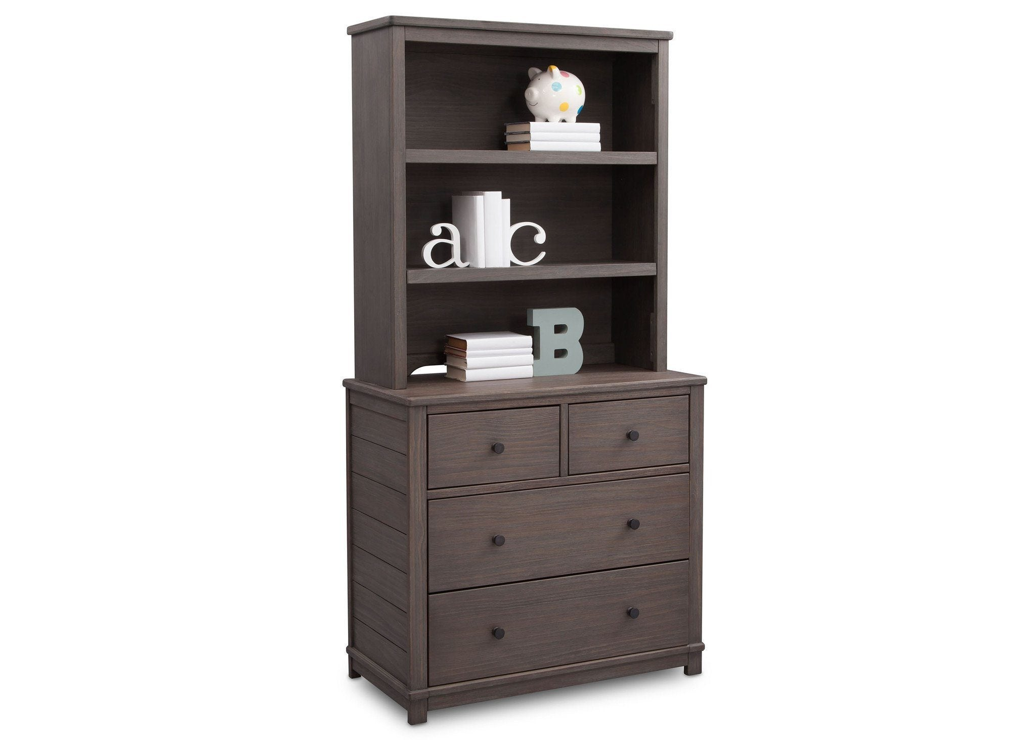 Simmons Kids Rustic Grey (084) Monterey Bookcase/ Hutch atop dresser with props, angled view a4a