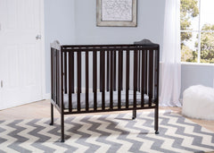 Delta Children Dark Espresso (958) Portable Folding Crib with Mattress, room shot c1c