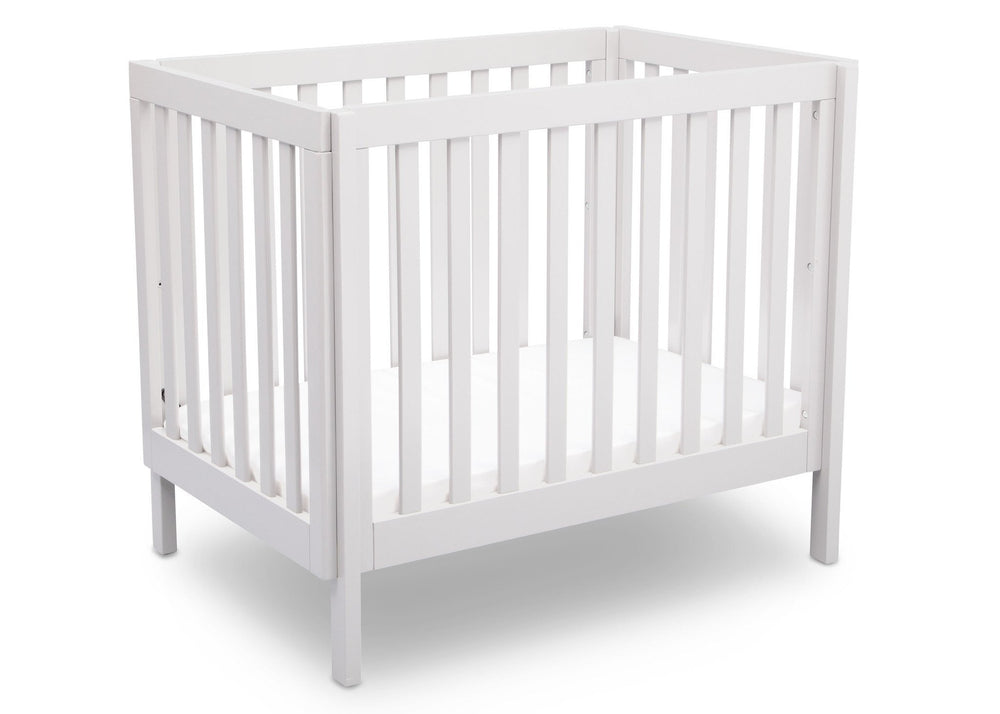 Delta Children White (130) Bennington Elite Mini Crib with Mattress, Angled View, a3a