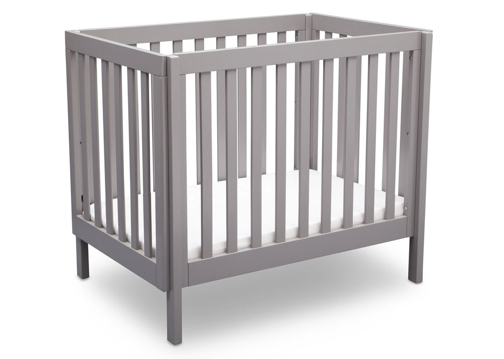 Delta Children Grey (180) Bennington Elite Mini Crib with Mattress, Angled View, c3c