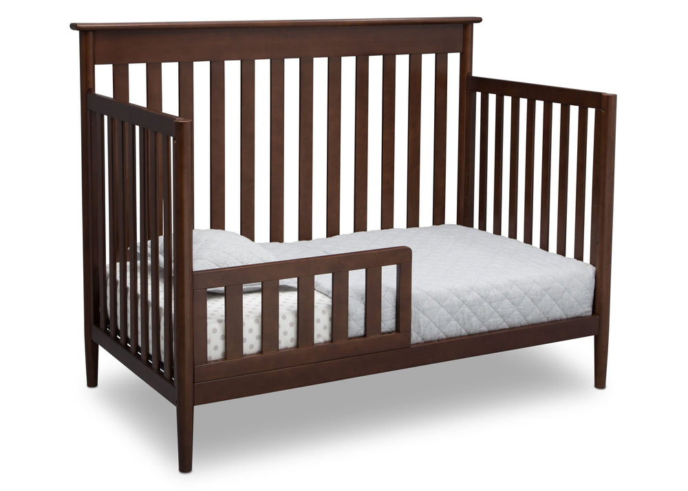 Delta Children Walnut (1316)) Greyson Signature 4-in-1 Crib, angled conversion to toddler bed, d5d