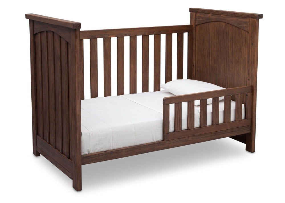 Serta Rustic Oak (229) Northbrook 3-in-1 Crib, Toddler Bed Conversion with Side View b4b