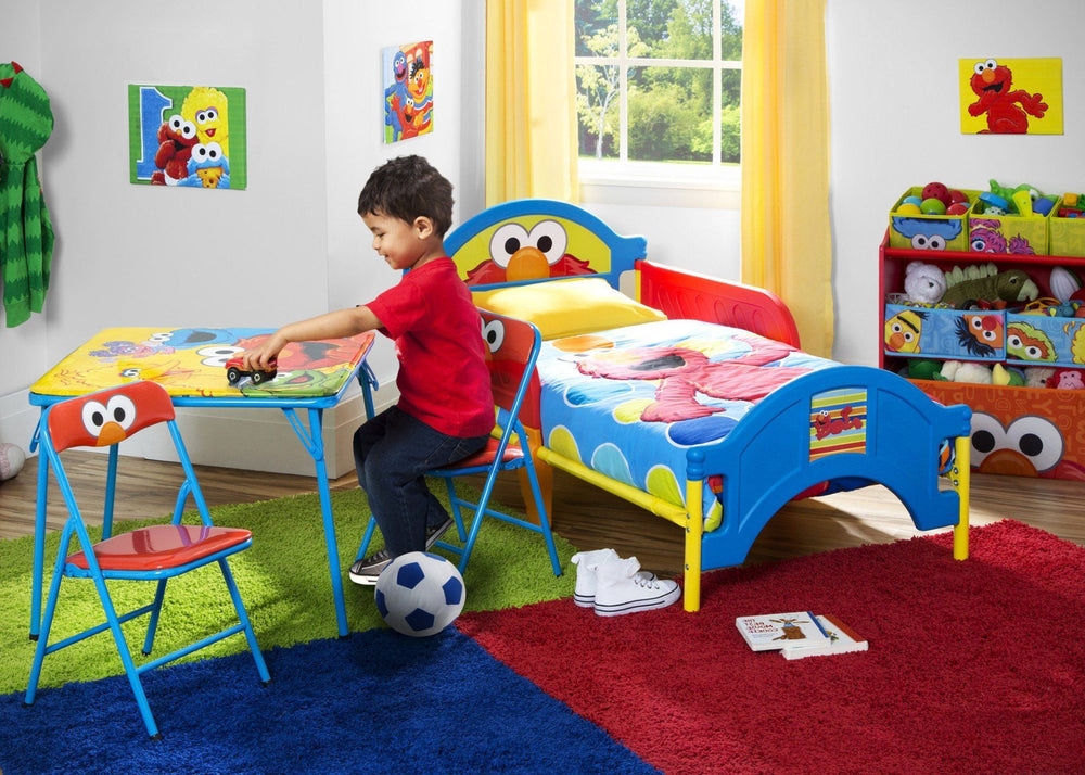 Delta Children Sesame Street Toddler Bed Left Side View with Props a1a