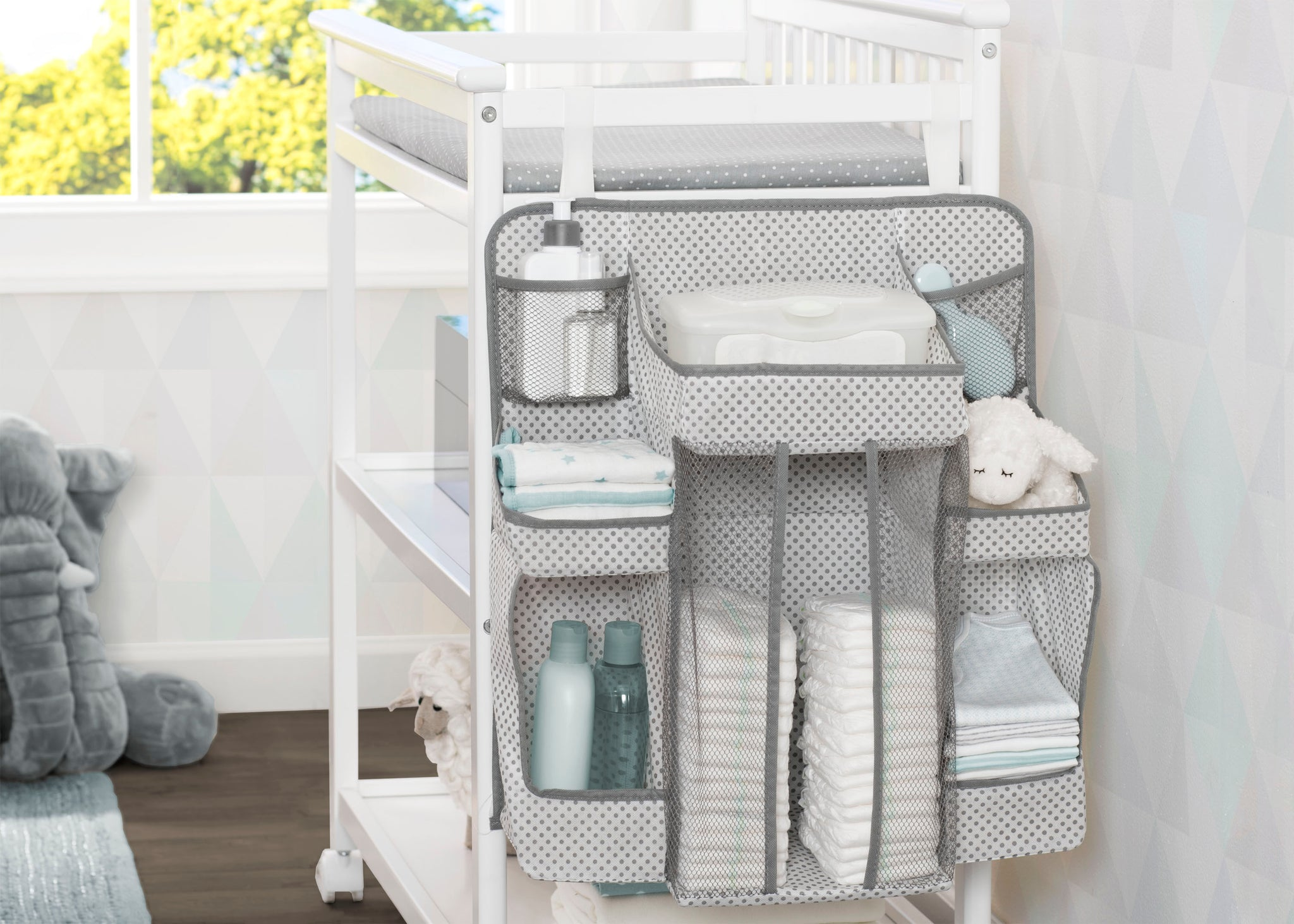 Delta Children Cool Grey (063) Universal Hanging Organizer for Changing Tables | Diaper Caddy | Nursery Storage Lifestyle View a1a