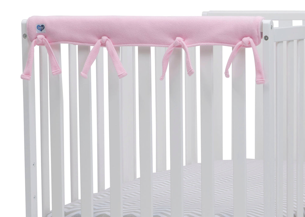 Delta Children Pink (654) Waterproof Fleece Crib Rail Covers/Protectors for Short Side Rails, 2 Pack, Rail Close Up View