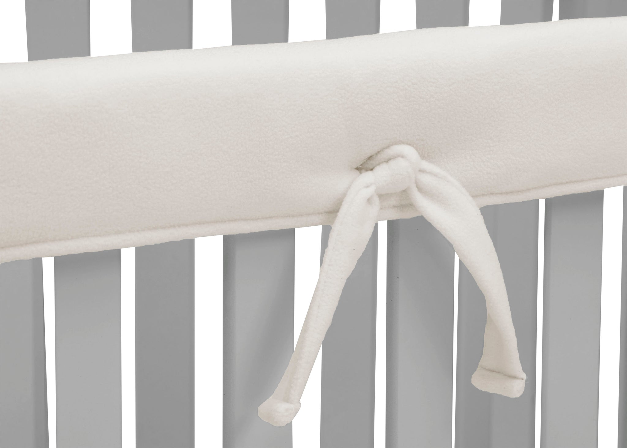 Delta Children Ivory (124) Waterproof Fleece Crib Rail Covers/Protectors for Short Side Rails, 2 Pack, Tie Detail View