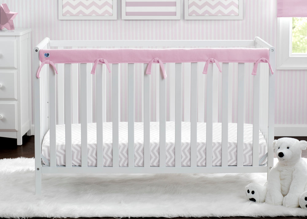 Delta Children Pink (654) Waterproof Fleece Crib Rail Cover/Protector for Long Front or Back Rail, 1 Pack, Lifestyle View