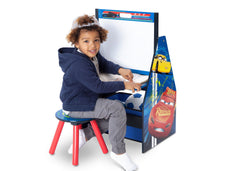 Delta Children Cars Activity Center - Easel Desk with Stool & Toy Organizer Easel Desk View with Model a3a