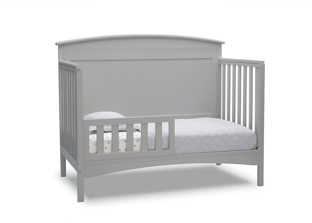 Delta Children Grey (026) Archer Deluxe 6-in-1 Convertible Crib, Right Toddler Bed Silo View