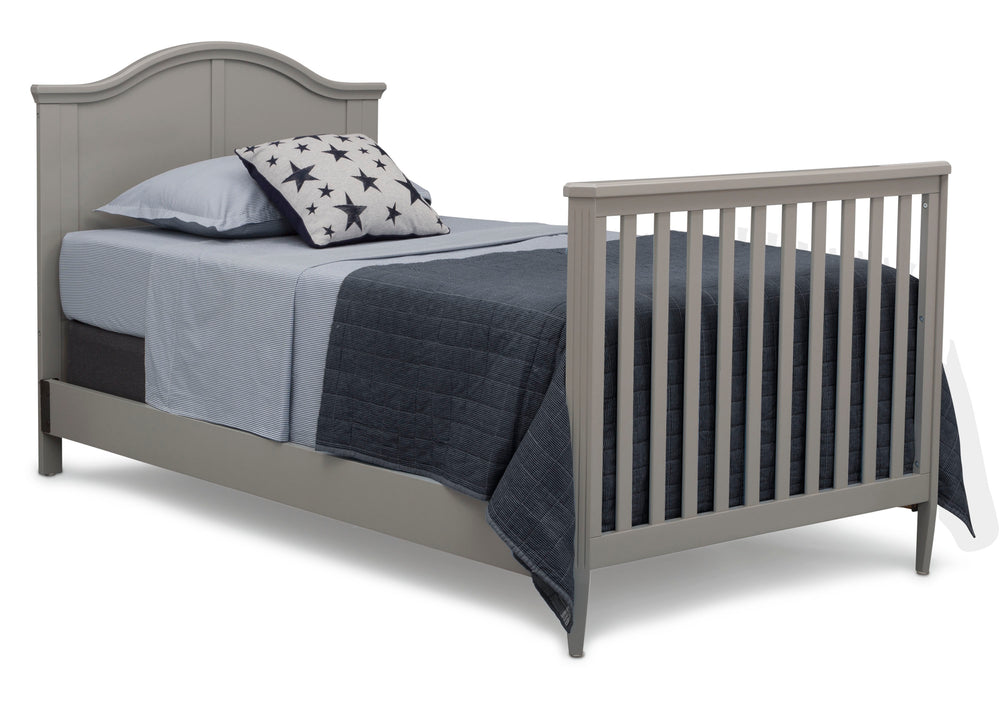 Delta Children Grey (026) Mini Convertible Baby Crib with Mattress and 2 Sheets Twin Bed Right Silo View