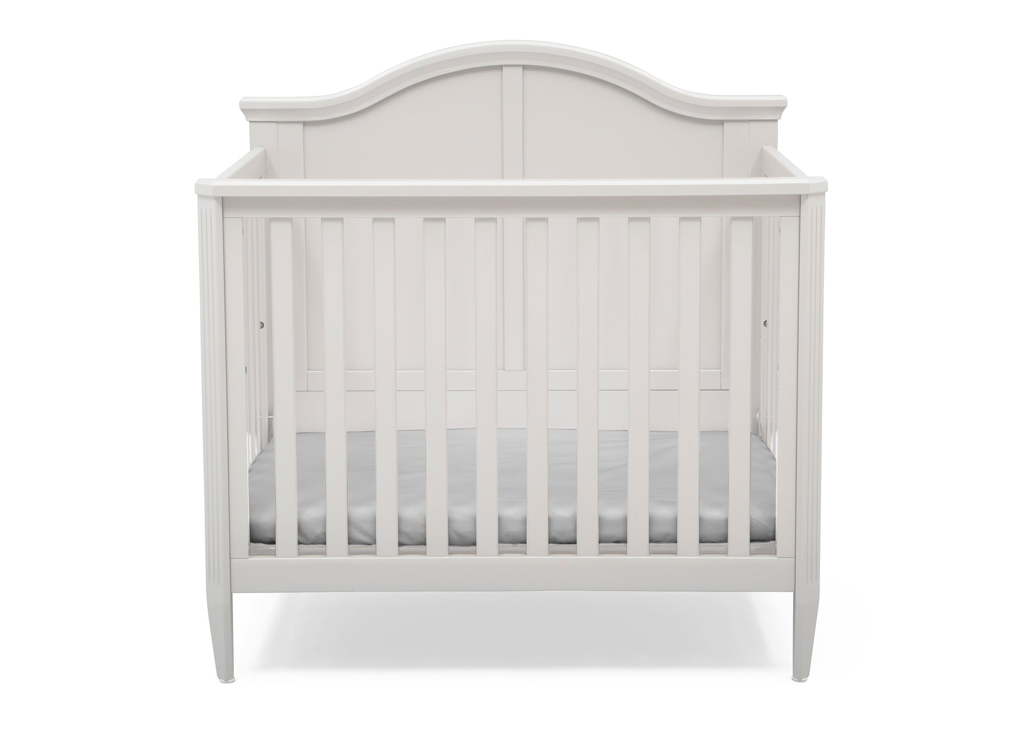Delta Children Bianca White (130) Mini Convertible Baby Crib with Mattress and 2 Sheets Front Crib Silo View