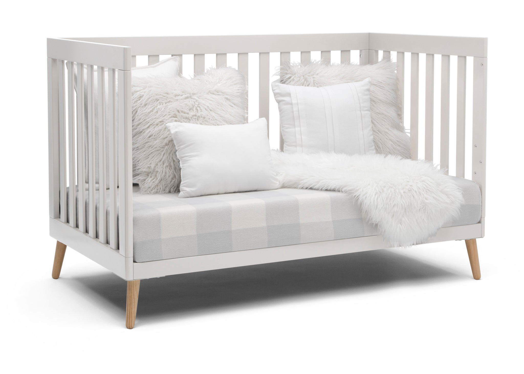 Delta Children White with Natural (123) Essex 4-in-1 Convertible Crib, Right Sofa Silo View