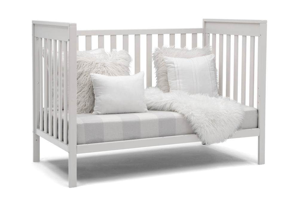 Delta Children Bianca White (130) Mercer 6-in-1 Convertible Crib, Right Sofa Silo View