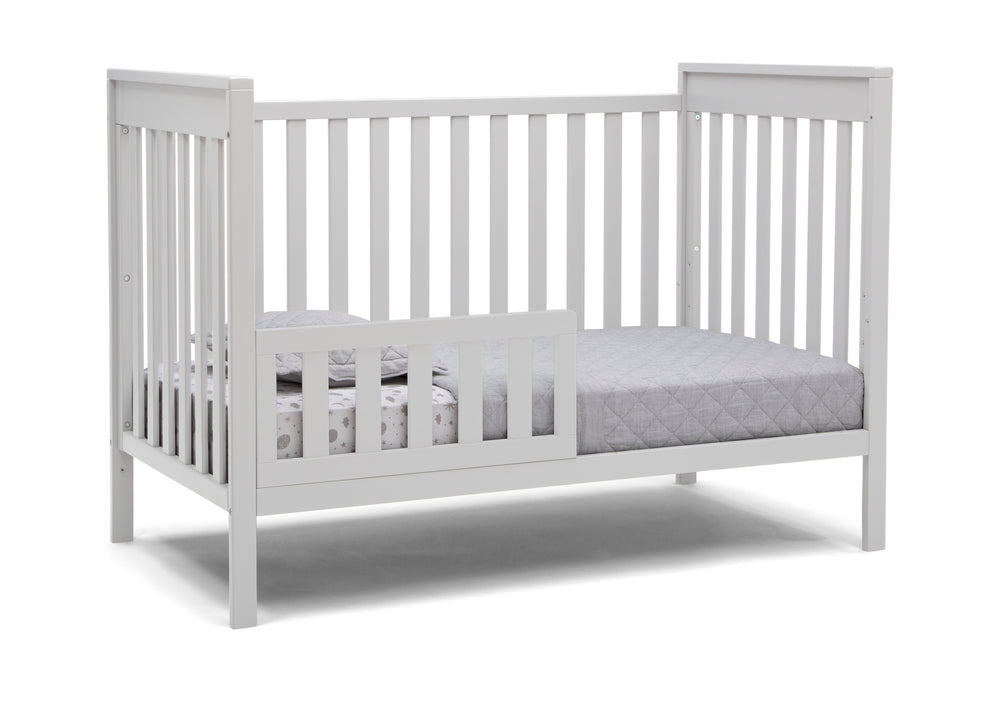 Delta Children Bianca White (130) Mercer 6-in-1 Convertible Crib, Right Toddler Bed Silo View