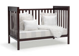 Delta Children Dark Chocolate (207) Mercer 6-in-1 Convertible Crib, Right Sofa Silo View