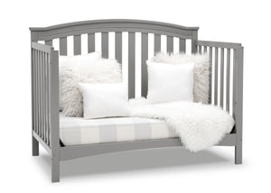Delta Children Grey (026) Waverly 6-in-1 Convertible Crib, Right Sofa Silo View