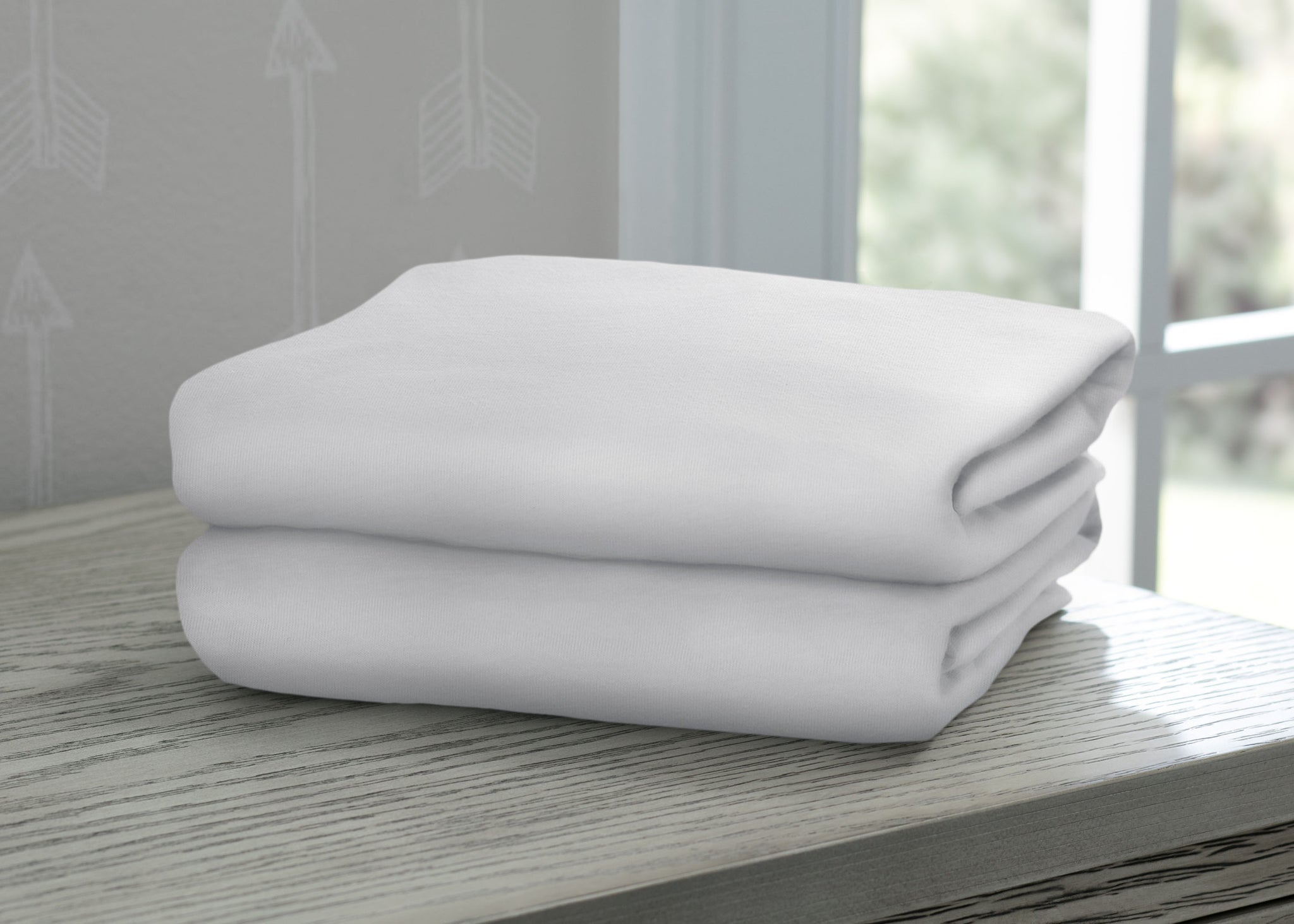 Delta Children White (100) Fitted Bassinet Sheet Set – 2 Pack Hangtag View