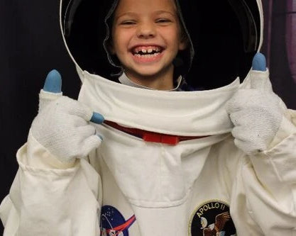 ISS Assemblies Girl-laughing-thumbs-up-astronaut-suit