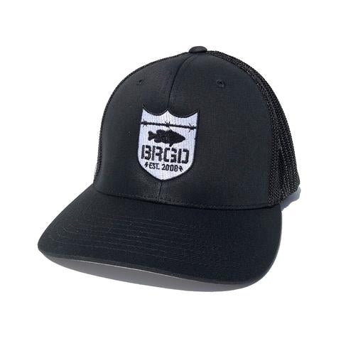 SHIELD LOGO FLEXFIT TRUCKER HAT - BLACK