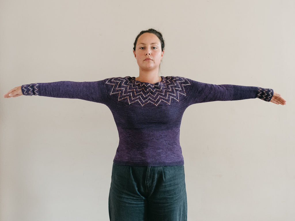 Model with arm raises, showing close fitting sleeves