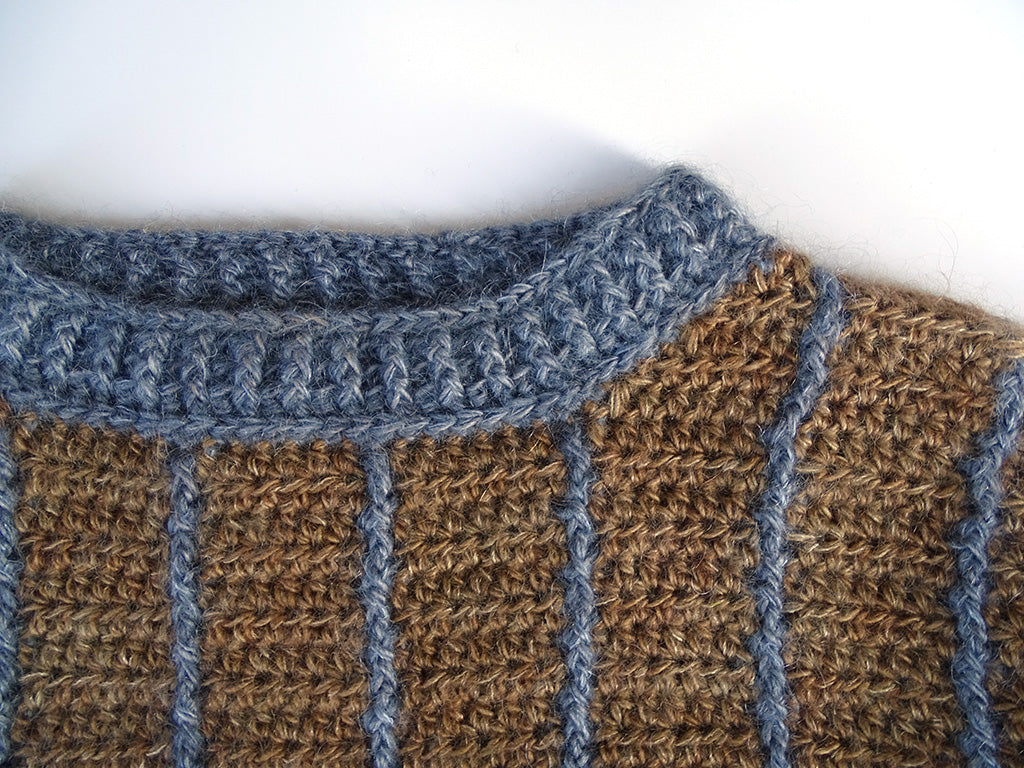 Close-up of neckline and neck ribbing