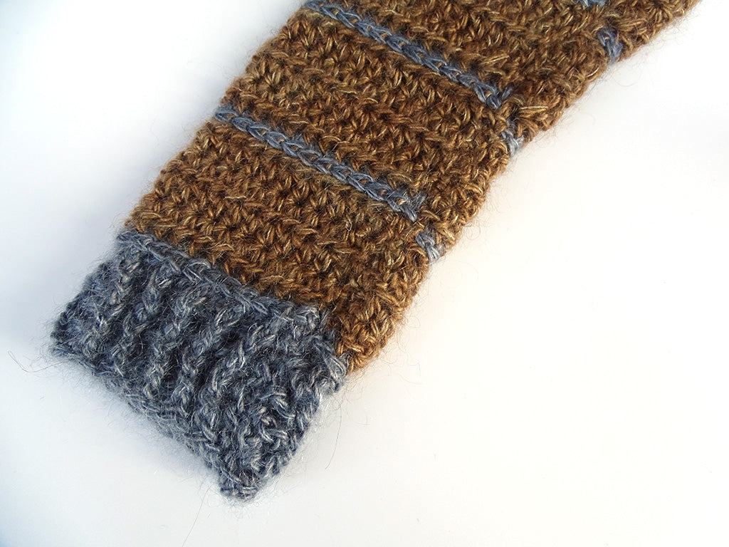 Close-up of sleeve bottom including ribbing and seam