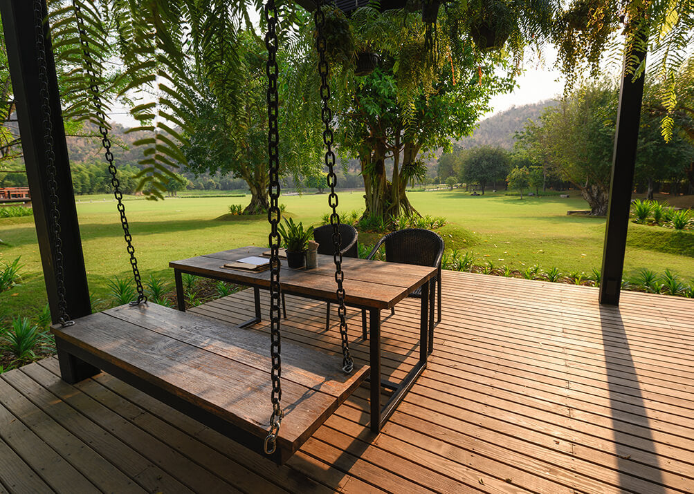 wooden terrace table and benches in the summer time