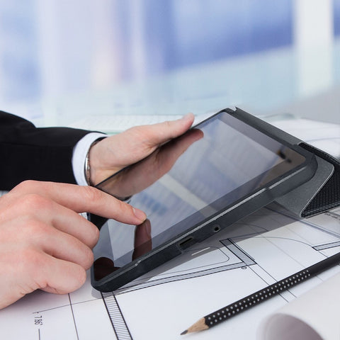 man in suit using ipad with eiger storm folio case