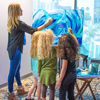 Kelly Quinn painting with kids
