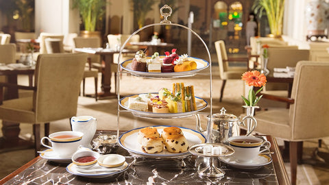 Afternoon tea set with pastries, sandwiches, scones and tea at Peninsula Hotel Hong Kong